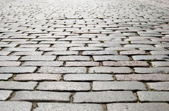 Stone blocks close up. Ancient road paved by a stone block Royalty Free Stock Photo