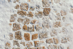 Stone blocks covered with snow. Texture stone Royalty Free Stock Photo