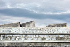 Stone blocks in dock to protect against sea Royalty Free Stock Images