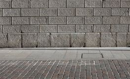 A stone blocks facade, a gray natural stone slabs sidewalk and a porphyr stock image