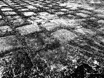 Stone blocks pavement black and white monochrome grunge effect illustration rough vintage pattern background for web and pri. Stone blocks floor pavement black stock photo