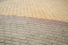 The stone blocks are rectangular in shape, lined with a semicircle of yellow lilac gray. royalty free stock image