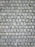 Stone blocks in the walkway. Old grey pavement Stock Photo