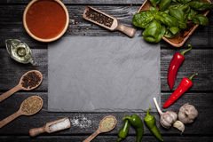 Stone board with different spices royalty free stock image