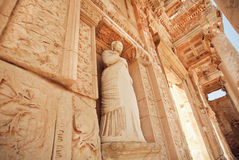 Stone body of greek goddess at entrance of historical Celsus Library in Ephesus, Turkey Royalty Free Stock Image