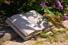 Stone Book in the garden Royalty Free Stock Images