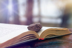 Stone on a Book royalty free stock photo