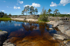 Stone bottom. Transparent water of Ladoga lake allows to see a stone bottom small bay Royalty Free Stock Images