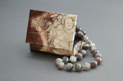 Stone box with the beads. Royalty Free Stock Photo