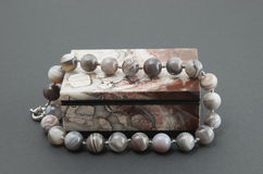 Stone box with the beads. Stock Photography
