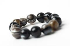 Stone Bracelet on white background. Bracelet with natural stones on white background royalty free stock photography