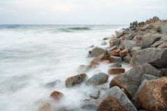 Stone breakwater Stock Images