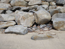 Stone breakwater on the beach royalty free stock photography