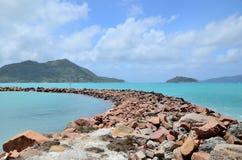 Stone breakwater. Stock Image