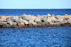 Stone breakwater for protection of coast Royalty Free Stock Photography