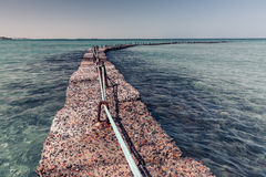Stone breakwater in the sea Royalty Free Stock Images