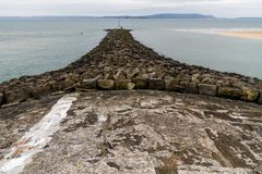Stone Breakwater. At Burry Port Harbour, Llanelli, Carmarthenshire, Wales Royalty Free Stock Photos