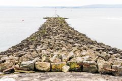 Stone Breakwater. At Burry Port Harbour, Llanelli, Carmarthenshire, Wales Stock Photography