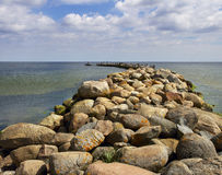 Stone breakwater. Stock Photo