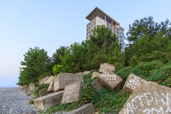 PITSUNDA, ABKHAZIA, SEPTEMBER 21, 2017: Stone breakwaters with inscriptions of tourists from different cities on the beach in Pits Royalty Free Stock Photography