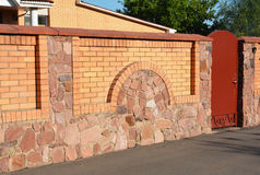 Stone, Brick and Metal Fence with Door of Modern Style Design stock images