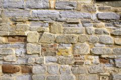Picturesque Gloucestershire - Tewkesbury. Stone and brick texture on an old worn and repaired wall, Tewkesbury, Gloucestershire, Severn Vale, UK Stock Image