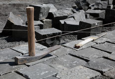 Stone or brick and tools. Laying stone or bricks using string and a specialty tool Royalty Free Stock Images