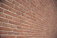Stone brick wall. Pattern of a red stone brick wall taken from an angle Royalty Free Stock Image