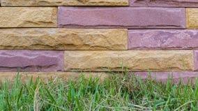 Stone brick wall. Background and bottom grass Royalty Free Stock Photo