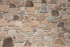 Stone brick wall. Detail of the texture of an old stone brick wall Royalty Free Stock Image
