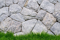 Stone Brick  wall and green grass Stock Photos
