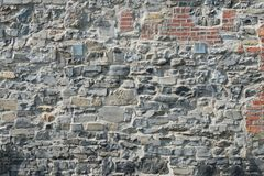 Stone and brick wall. Old stone and brick wall, Montreal, Quebec, Canada Royalty Free Stock Images