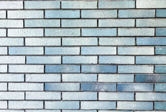 Stone brick wall textured background. In gradient blue color Stock Images