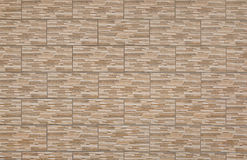 A STONE BRICK WALL. TEXTURES OF A BROWN STONE BRICK WALL AS BACKGROUND Royalty Free Stock Images