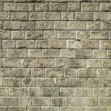 Stone brick wall with  weathered cement  background Royalty Free Stock Images