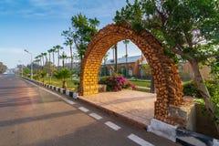 Stone bricks orange arch leading to the royal plant nursery at Montazah public park, Alexandria, Egypt. Stone bricks orange arch leading to the royal plant Stock Photo