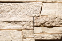 Stone bricks on the wall as a background.  Stock Photos