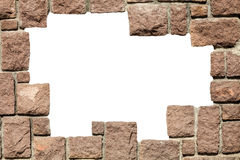 Stone bricks wall frame with empty hole. PNG available. A wall of stone bricks with white space in the middle. Frame brick wall rocks. PNG available Royalty Free Stock Photo