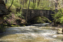 Stone Bridge. Accross rapidly moving stream Stock Photo