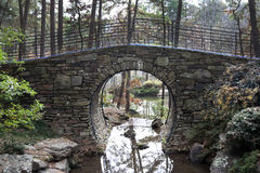 Stone Bridge. A bridge spanning over a small pond made of stone Royalty Free Stock Photos