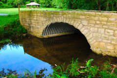 Stone Bridge. This is a stone bridge. It is located on a spill way for an old mill Stock Photo
