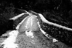 Stone bridge. An old roman bridge in winter with snow royalty free stock photos