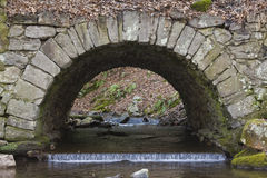 Stone Bridge. Over a creek Stock Photo
