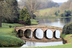Stone Bridge. Across a lake in Somerset Royalty Free Stock Images