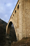 Stone bridge. Old stone railroad bridge with big single vault royalty free stock photo