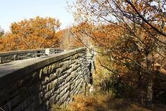Stone Bridge in Acadia. Stone bridge part of the carriage trail system in autumn colors in Acadia National Park Royalty Free Stock Photo