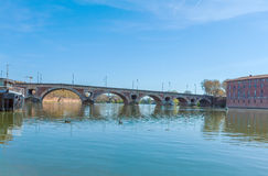 Stone Bridge across Garonne, Toulouse. Pont (Bridge) Neuf (XVII c.) across Garonne in Toulouse, France Royalty Free Stock Photos