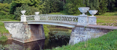 Stone bridge across small river Royalty Free Stock Photography