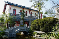 Stone bridge before archaised Chinese building in sunny winter Royalty Free Stock Images