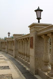 Stone bridge banisters and lighting lamps and lanterns. Stone bridge banisters and lighting lamps in a park Stock Photos